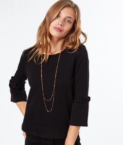 Sweat-shirt en coton noir.