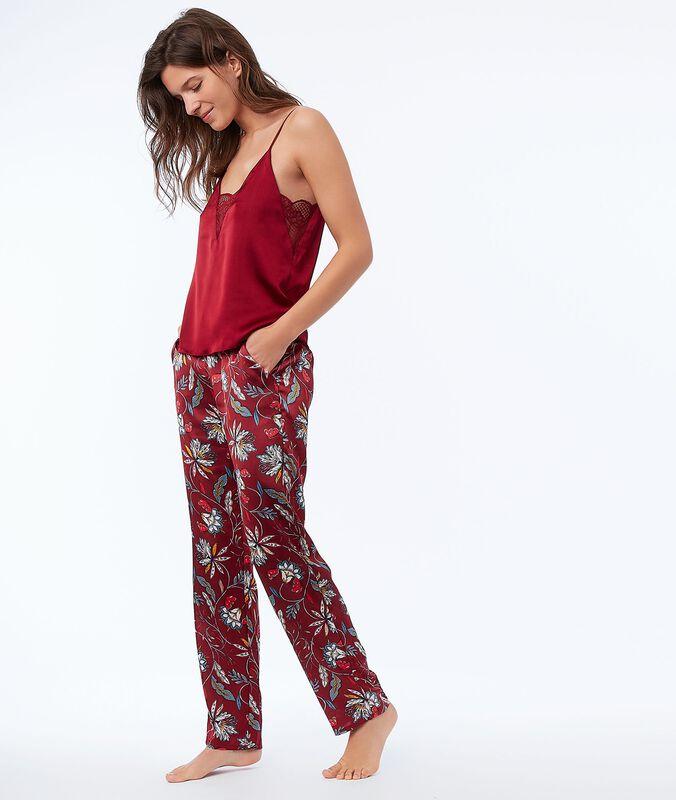 Pantalón de satén estampado floral rojo.
