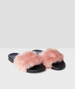 Zapatillas tipo chancla pelo sintético rosa.