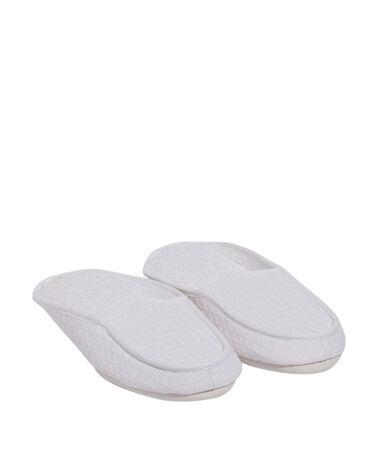 Zapatillas estampado relieve blanco.