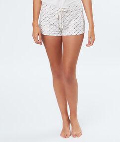 Pantalón corto estampado a lunares blanco.
