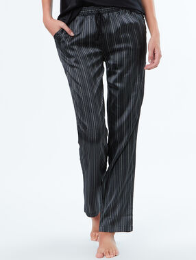 Pantalón estampado a rayas satén negro.