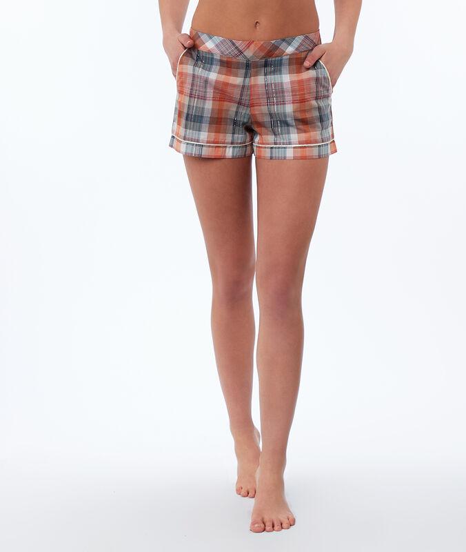 Pantalón pijama estampado de cuadros naranja.