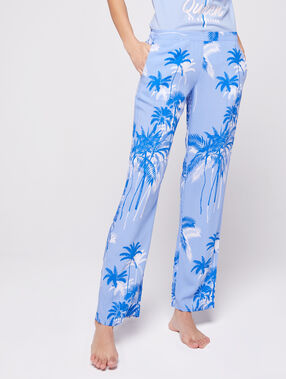 Pantalón estampado palmeras azul.