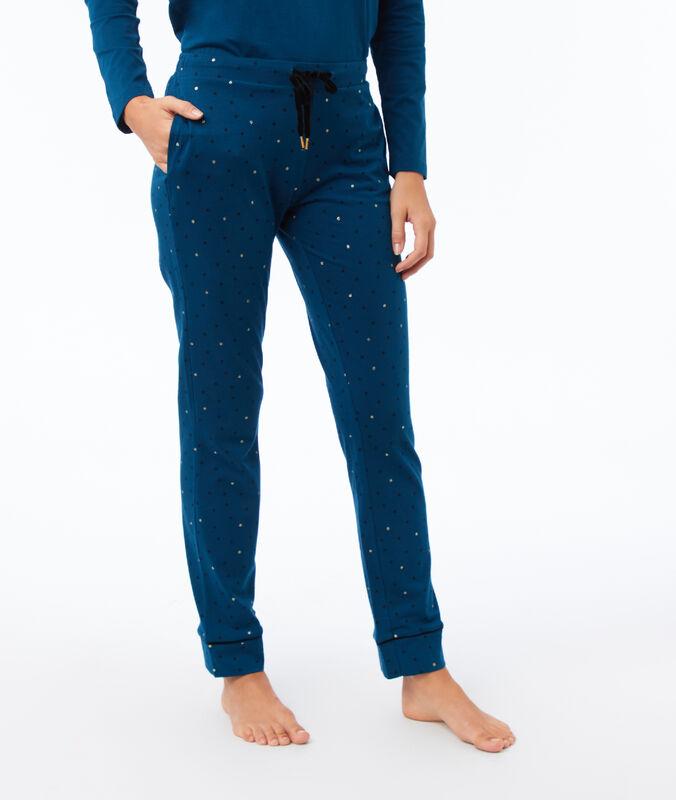 Pantalón estampado de lunares azul.