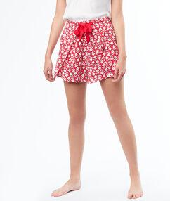 Pantalón corto holgado estampado floral rojo.