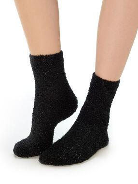Calcetines gruesos con lentejuelas negro.