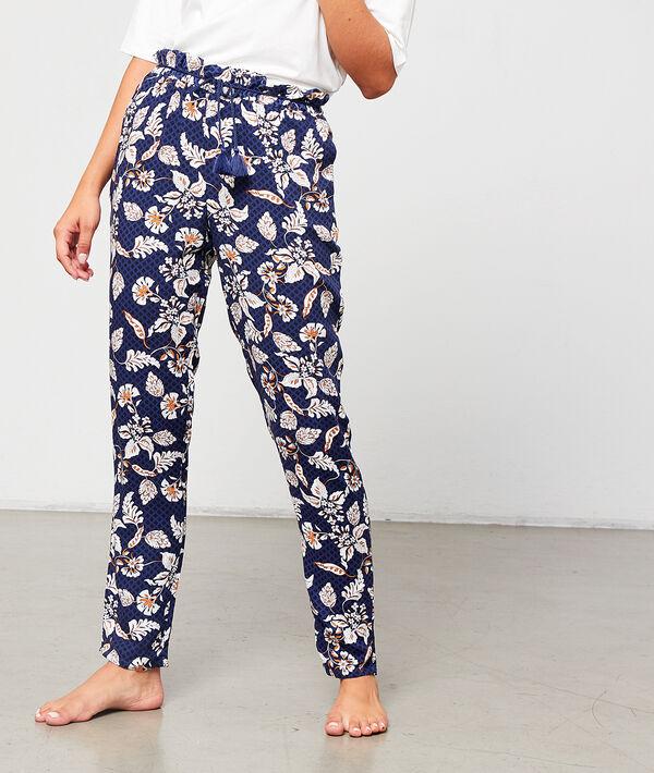Pantalón estampado floral con pompones decorativos