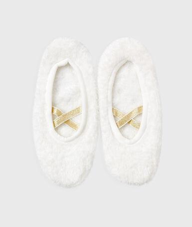 Zapatillas estilo bailarina blanco.