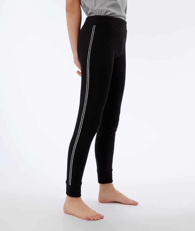 Pantalón elástico franja metalizada negro.