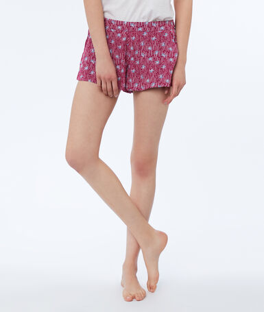 Pantalón corto estampado floral burdeos.