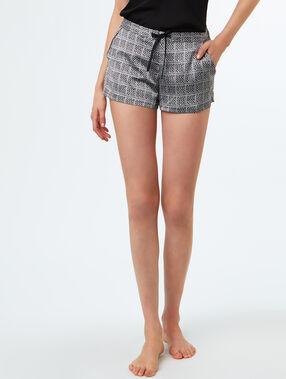 Pantalón corto estampado crudo.