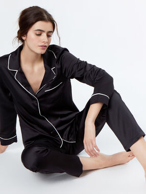 Pantalón de satén bolsillos contrastados negro.