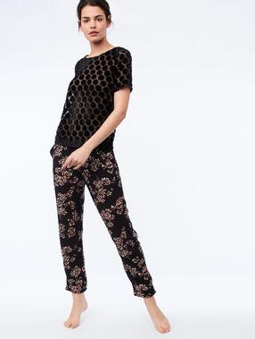 Pantalón largo estampado floral negro.