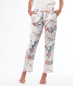 Pantalón largo estampado floral blanco.