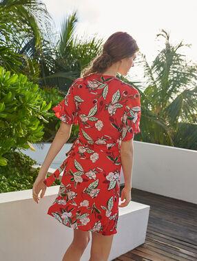 Vestido escote cruzado estampado floral y volantes rojo.