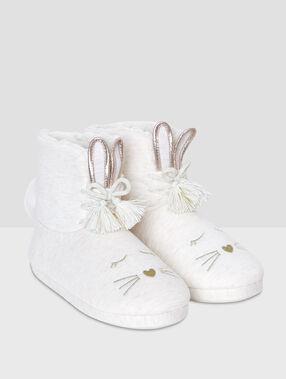 Zapatillas tipo botines conejos crudo.