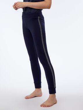 Pantalón elástico franja metalizada azul marino.