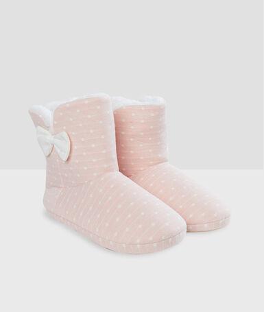 Zapatillas tipo botines estampado lunares rosa.