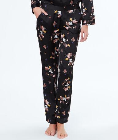Pantalón satén estampado floral negro.