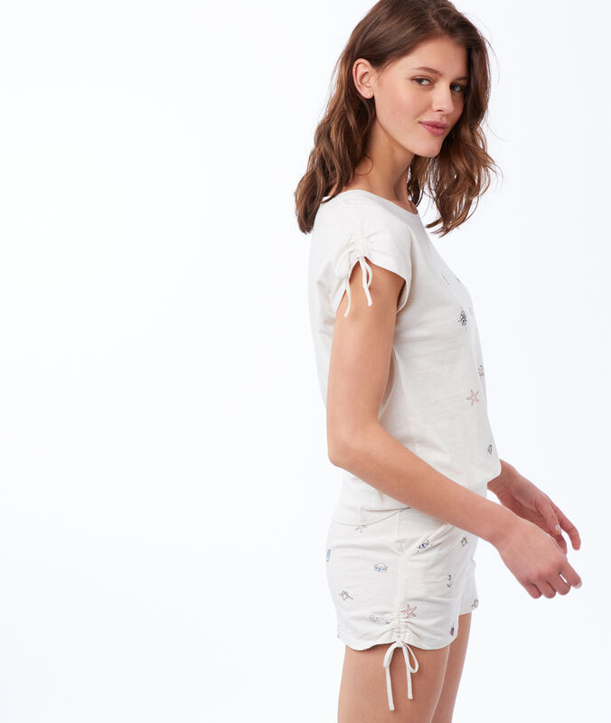 Pantalón corto estampado motivos marinos blanco.