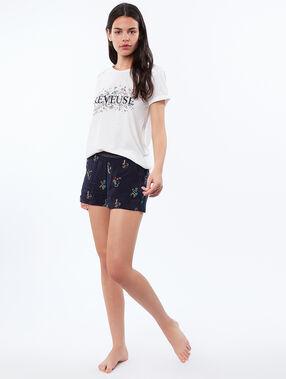 Camiseta algodón con mensaje blanco.