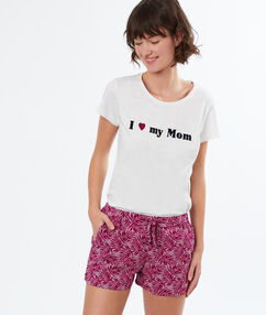 Pantalón corto estampado palmeras violeta.