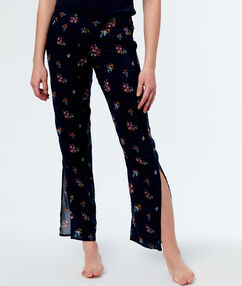 Pantalón largo estampado floral azul.