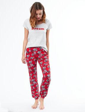 Pantalón holgado estampado floral rojo.