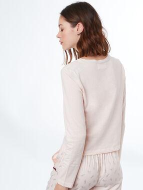 Camiseta manga larga mensaje rosa.