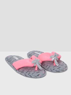 Zapatillas tipo chancla palmeras brillantes rosa.