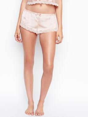 Pantalón corto holgado rosa pálido.
