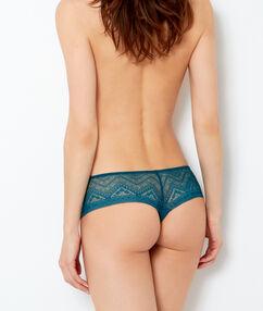 Tanga de encaje geométrico verde azulado.
