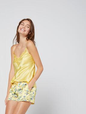 Pantalón de satén estampado floral amarillo.