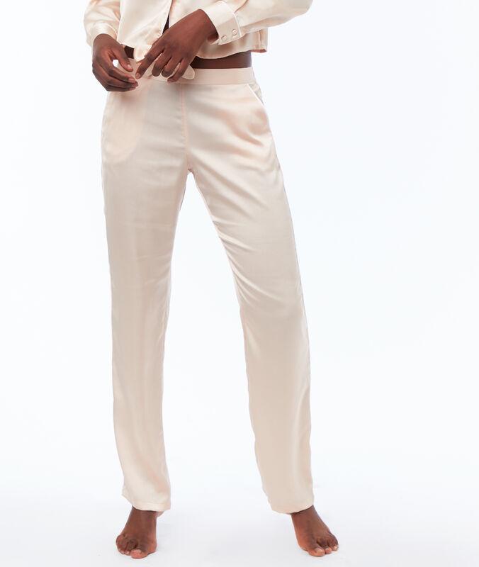 Pantalón pijama satén rosa pálido.
