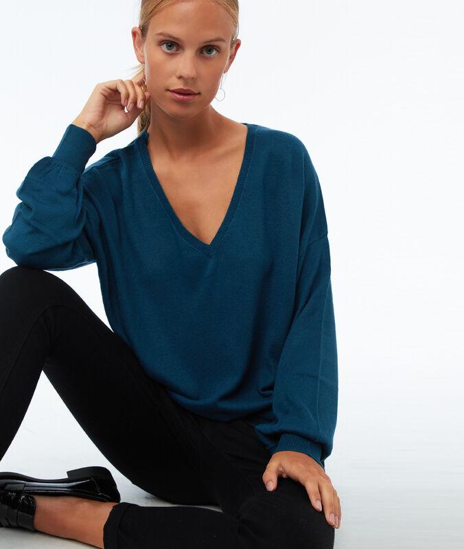 Jersey manga larga escote en v azul noche.