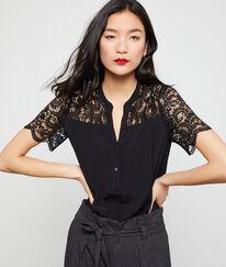 Blusa con detalles de guipur