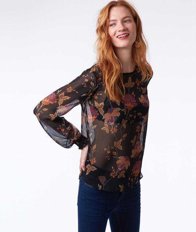 Blusa semitransparente estampado floral negro.