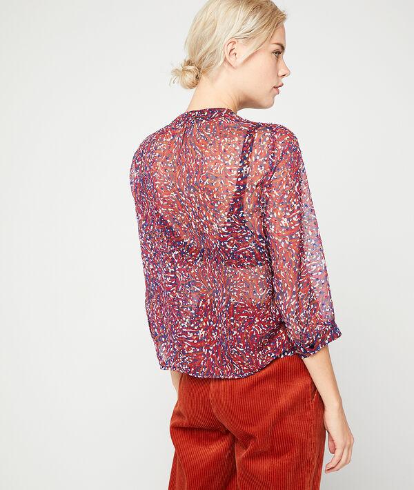 Blusa transparente de plumetis