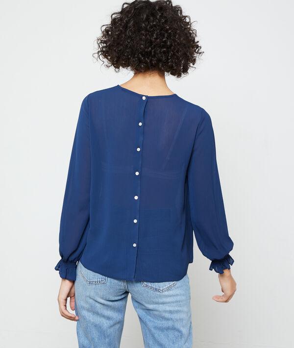 Blusa abotonada a la espalda