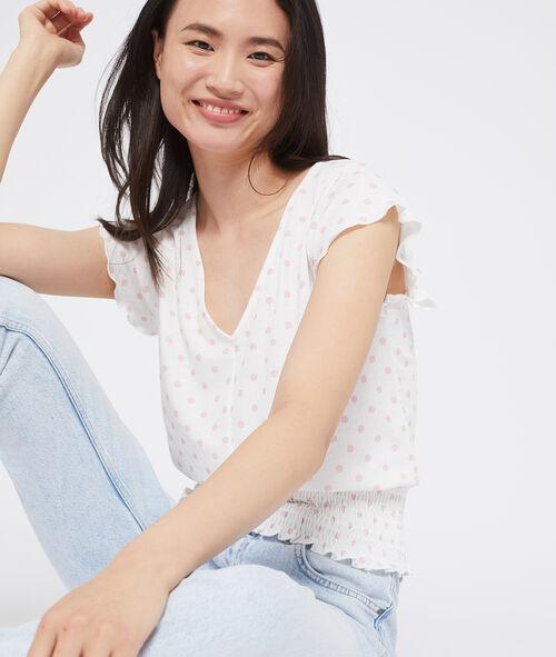Camiseta ancha con cintura ceñida