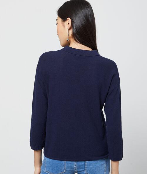 Suéter con escote calado