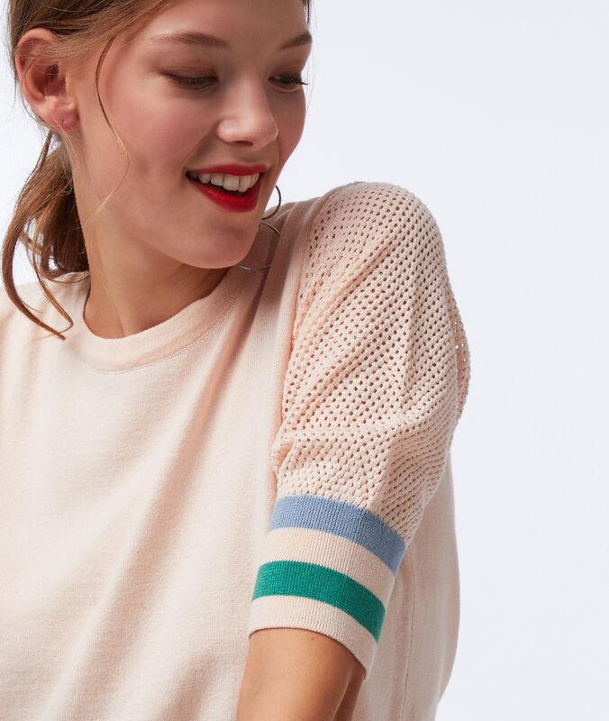 Jersey algodón y tejido rejilla rosa pálido.