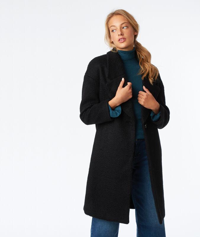 Abrigo oversize de lana negro.