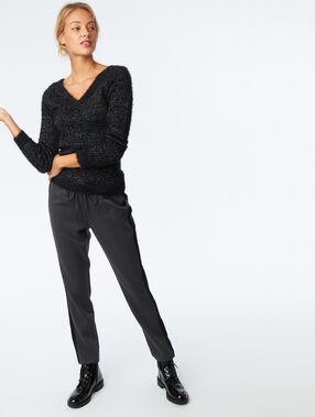 Jersey tejido peluche fibras metalizadas negro.