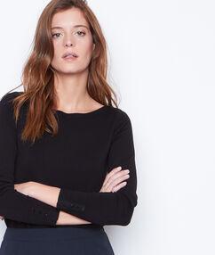 Jersey de punto fino cuello barco negro.