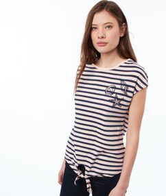 Camiseta manga corta estampado rayas maquillaje.