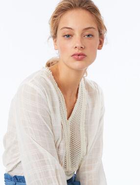 Blusa de algodón cuello tunecino crudo.