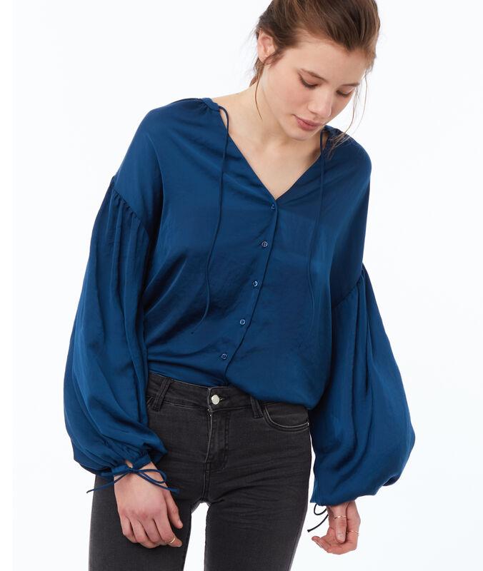 Blusa mangas oversize azul.