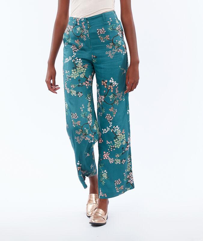Pantalón largo estampado floral turquesa.
